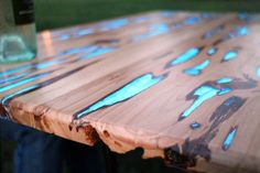 Really light up your next dinner party with a table that glows in the dark! Photoluminescent (glow) powder mixed with clear casting resin fills the naturally formed voids in this Pecky Cypress hardwood, creating a unique and stunning table. The glow powder charges up in sunlight and emits a cool blue glow when in partial or complete darkness.