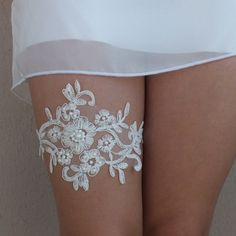 Wedding Garter    This beautiful wedding garter includes a gorgeous lace garter on the main. If you specify a custom size when purchasing the 22-inch is sent.      **PLEASE INCLUDE YOUR THIGH MEASUREMENT AT CHECKOUT.    SHIPPING    I usually ship the items right on day with Turkish Post. Turkish Post forwards the item next day to the destination country. Here are the AVERAGE durations of the posts that I could learn from the previous posts:  Products 24 hours after purchase, mail given…