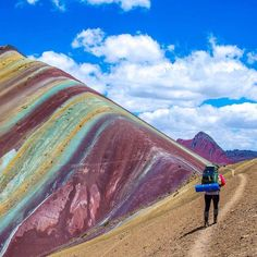 """⛰ Location: @bamorris5 walking along the rainbow mountains of Vinicunca, Peru. Tour Operator: @flashpackerconnect Photo Credit: @bamorris5"""