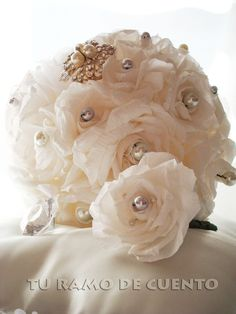 Paper flowers wedding bouquet. You can find it at: http://facebook.com/weddingpaperflowers