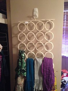 Storage for scarves (hanger is from Ikea) - organizing the coat closet-why haven't I bought  this already