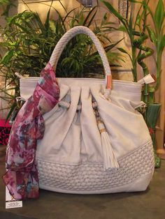 A Great Neutral Tone Handbag with a beautiful summer Scarf, goes easy with many outfits.