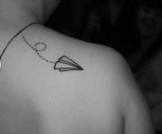 Paper air plane :) I really like it because to me I see it as the paper plane representing my childhood and it flying in the air means I'm still going on. Still immature yet growing!!:)