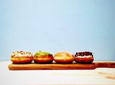 Colorful donuts. White chocolate, matcha green tea, sugar, crunch