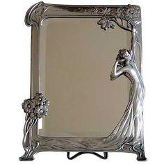 The Echo Art Nouveau figural pewter mirror