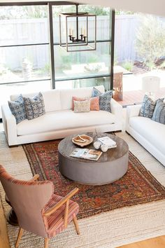 Hand-Woven Natural Area Rug and Vintage Rug How to layer rugs Rug layers Two rugs - Home Bunch