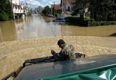 Rescue workers drive through the flooded town of Obrenovac - May 2014 #HelpSerbia #GodSaveSerbia