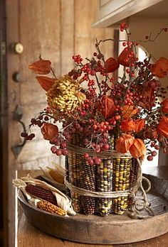 Whupsadaisy Creations: 20 DIY Fall Decorations: Remove husks from corn. Wrap rubber band. Insert corn beneath rubber bands. Cover rubber bands with twine. Fill with favorite autumn naturals.