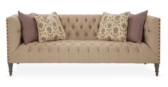Low-slung chic: This sofa features a streamlined profile with elegant details like tufted Belgian linen, nail-head trim, and turned legs. The feather-and-down bench seat makes this your spot for...