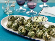 Recipe of the Day: Rachael's Greek Meatballs	 If you know and love the Greek spinach pie, Spanikopita, you'll be all about these meatballs. Rachael brings spinach and salty feta into her meatball mixture for one-bite meaty treats, best dunked in a tangy Greek yogurt dipping sauce.