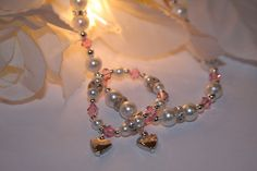 Baby's Gotta have Bling! Mommy & Me matching heart charm stretch bracelets.