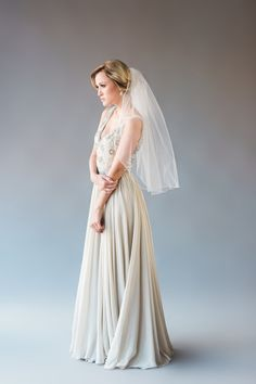 CRYSTAL VEIL DESCRIPTION: single tier elbow length veil, embroidered detail at edge of veil Veil is made of soft bridal illusion tulle and has