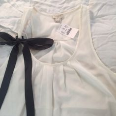 """NWT J. Crew Cream Blouse New J. Crew Factory blouse, off white with grey bow. Pleats on the front, flat back. So cute! Perfect for spring/summer when you want to look nice but stay cool! I don't take PayPal or Mercari but I'm always willing to negotiate! Please use the """"Offer"""" button! J. Crew Tops Tank Tops"""