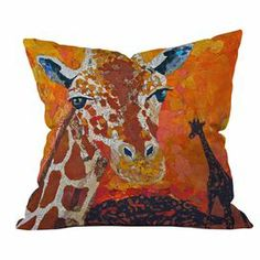 """Add a pop of exotic style to your sofa or arm chair with this delightful pillow, showcasing a whimsical giraffe motif. Made in the USA.  Product: PillowConstruction Material: PolyesterColor: Orange, red, brown and yellowFeatures:  Custom made for every orderGiraffe motifWoven Insert included Made in the USA  Dimensions: 18"""" x 18"""" Cleaning and Care: Machine washable"""