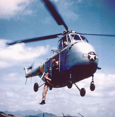 Airman Hoisted onto SH-19, Korea by  Unknown Artist
