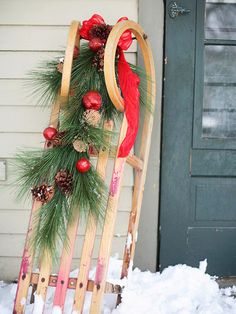 Christmas Sled - love a decorated sled for a porch decoration! More easy holiday decorating ideas: http://www.bhg.com/christmas/indoor-decorating/christmas-decorating-using-what-you-have/
