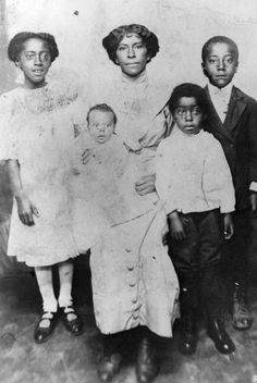 Martha J. Stevens Perkins and her four children. Martha was the daughter of Green Flake who entered the Salt Lake Valley with Brigham Young and the first pioneers. His name is among those inscribed on the statue of Brigham Young in downtown Salt Lake. Photo Courtesy Utah State Historical Society