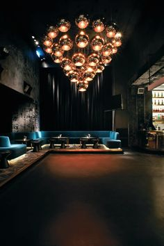 interior design club, chandelier glass, blue velvet sofa, interior design projects hospitality