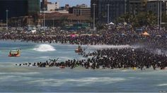 Humans have always been drawn to water. In Durban, South Africa, lifeguards had to stem the tide of revelers on New Year's Day South Africa Beach, World Architecture Festival, New Year 2014, Africa Travel, Black People, Where To Go, Cool Pictures, Dolores Park, Places To Visit