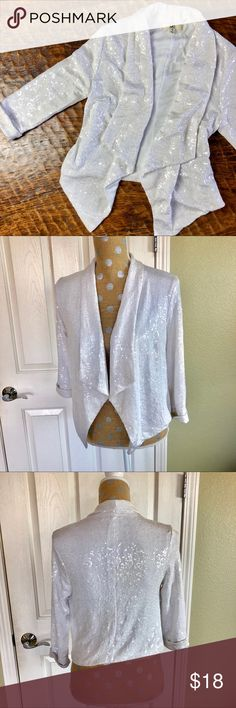 """Ya Sparkly White Stretchy Knit Cropped Jacket Add a bit of shine and sparkle to your outfit. White Cropped  jacket with clear sequins. Fitted and sexy over a little black dress or super cool over distressed jeans. 16"""" pit to pit, 18"""" length in the back.   In excellent used condition Ya Jackets & Coats"""