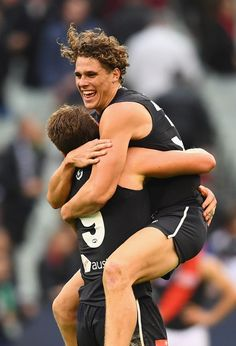 Patrick Cripps Photos - Charlie Curnow and Patrick Cripps of the Blues celebrate winning the round eight AFL match between the Carlton Blues and the Essendon Bombers at Melbourne Cricket Ground on May 12, 2018 in Melbourne, Australia. - AFL Rd 8 - Carlton vs. Essendon Carlton Afl, Carlton Football Club, Australian Football League, Rugby Men, Trophy Wife, Fitness Photography, Athletic Men, Sports Pictures, Sport Man