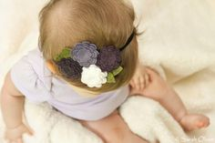 I know this is on a baby... but I would Love to wear this adorable headband.
