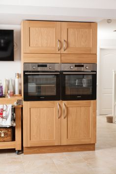 ovens sit side-by-side at eye level with ample storage both above and below each cooker. http://www.solidwoodkitchencabinets.co.uk/gbu0-display/full_height_cabinets.html
