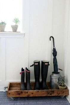 DIY: How to Build a Boot Tray - via Magnolia Homes. I love that this has wheels! It would make it much easier to move around for cleaning.
