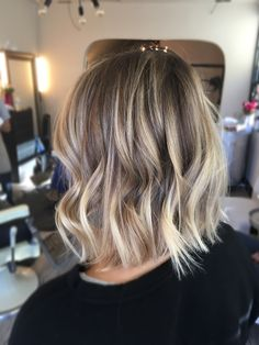 Blonde dimensional Balayage :) and a long bob razored for texture...