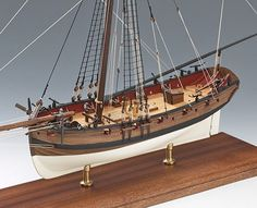 Lady Nelson is a wooden model of a cutter rigged ship, armed with 10 carriage guns and 8 swivel guns. This beautifully designed wooden model kit will build into a small masterpiece. Wooden Ship Model Kits, Model Ship Kits, Wooden Model Boats, Model Ships, Cutter Ship, Model Ship Building, Model Boat Plans, Make A Boat, Doll House Crafts
