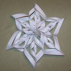Snowflakes- easy DIY project. I made one of these before... well, I guess it was more my creative friend who figured it out and I helped lol... but they're fun and so pretty!