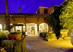 Hotel Lucrezia | Italy Oristano Sardinia. Step through a door in an old wooden gate and discover a magical courtyard garden. Country-house bedrooms wait, as do golden sands