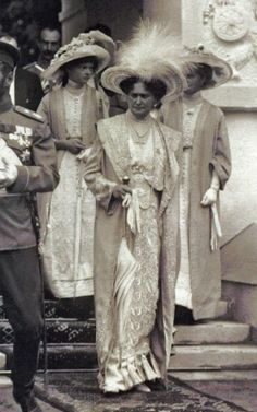 "Empress Alexandra Feodorovna of Russia with the Grand Duchesses Tatiana and Olga Nikolaevna Romanova of Russia.Tsar Nicholas is at the far left in the summer of 1914 just before the War commenced.  ""AL"""