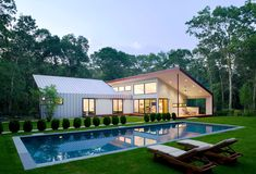 Tucked away in the Northwest Woods of Long Island's East Hampton, this award-winning home by Eisner Design conveys a clearly articulated harmony between the house and the landscape.