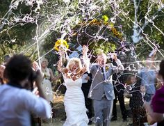 fun exit for a wedding and clearly makes for great pictures. Everyone has fun with silly string and it is a unique exit that not many people think of having. It is clear everyone is having a blast. Let your guests at some silly string and they will surely never forget your special day.