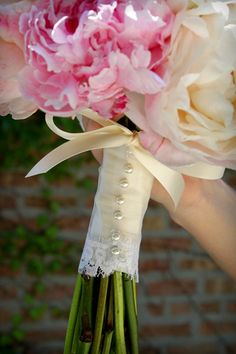 The cutest peony and sweet pea bouquet treatment of vintage lace and pearl pins