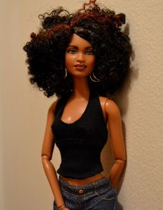 Tangie is a fully repainted, anatomically correct Barbie. She is a So in Style Trichelle doll.