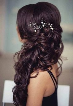 wedding hair pinned half way up with a curly style... so beautiful! perfect for brunette long hair and the clip looks like it has pearls and tree branches LOVE IT