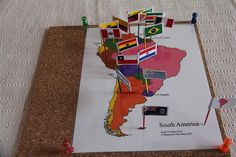 Montessori Map and Flag Pins on cork board.  What a great hands on way to identify different countries.