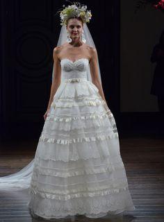 Naeem Khan Fall 2016 strapless ball gown with bow belt and silk-tiered skirt detail | https://www.theknot.com/content/naeem-khan-wedding-dresses-bridal-fashion-week-fall-2016