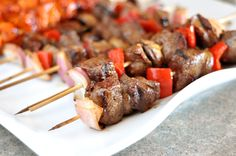 These Grilled Steak and Veggie Kebabs from Mel's Kitchen Cafe are easy to make and full of flavor. Steak tips marinated in soy sauce and garlic are paired with peppers, onions and mushrooms for a delicious, easy, grilled meal for your next barbecue.