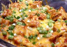 In the crock pot ~  Chicken breasts, enchilada sauce, taco seasoning, shredded cheese, and green onions.  add some cilantro to the top, then served up in soft tortillas with rice.  YUMMY and EASY - Source http://pinterest.com/pin/482377810058244718/