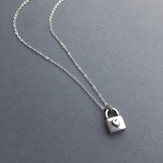 Silver Padlock Pendant; handcrafted in fine silver (.999%). Super cute! A made-to-order item where you pick your own chain length. Hangs on a sterling silver chain, and a must-have! ($60) #silverjewelry #modernjewelry #handmadejewelry