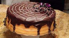 Spider Web cake for Halloween... chocolate cake, 'blackout' filling, vanilla bean butter cream frosting with salted caramel and orange coloring, and chocolate ganache dripping....