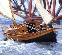 If anyone knows where we can get plans for this boat, please drop me a line. Never had such a little sailboat stirred my imagination. Such a little beauty - I must have her! Bateau Pirate, Small Yachts, Wooden Sailboat, Classic Sailing, Classic Boat, Small Sailboats, Classic Wooden Boats, Wooden Ship, Boat Stuff