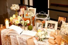 Family photos in antique / vintage photo frames for the guestbook table - so beautiful