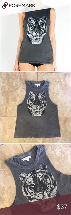"""Spiritual Gangster Tiger Namaste Rocker Tee Tank M Spiritual Gangster tiger namaste rocker tee / tank top / sleeveless muscle t-shirt. Size medium. Gently worn a few times. No holes, rips, stains, etc. Relaxed, oversized fit with low arm holes. The fabric has a worn-in, vintage look and feel. Approx 25.5"""" long down the back center. 100% cotton. Soft and stretchy. Spiritual Gangster is in metallic gold script lettering underneath the tiger's face. Difficult to capture on camera, but it's…"""