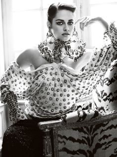 An almost unrecognizable Kristen Stewart, photographed by Mario Testino. Loving the beaded gown and oversized earrings.