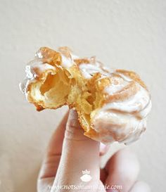 French Crullers with Honey-Sugar Glaze  from Doughnuts: Simple and Delicious Recipes to Make at Home  yields roughly one dozen  1 cup water  3 oz (6 tablespoons) unsalted butter, cubed  10 grams (2 teaspoons) superfine sugar  1/4 teaspoon salt  135 grams (1 cup) all-purpose flour, sifted  3 large eggs  2 large egg whites    vegetable oil for frying