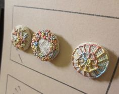 Hand embroidered bullion stitch button in green by theglasspingle
